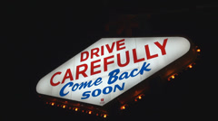 Drive carefully sing good bye Las Vegas Strip famous sin city party information  Stock Footage
