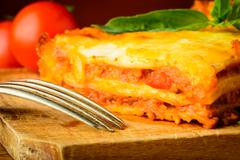 lasagne bolognese closeup - stock photo