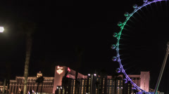 HD tight left High Roller worlds largest Ferris wheel by night time lapse 28mm Stock Footage
