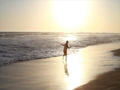 Huntington Beach Sunset with a child playing in the sand 540P Stock Footage