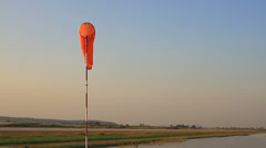 Windsock at an airfield - stock footage