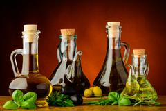 Different bottles of infused olive oil Stock Photos