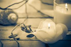 Scented candles attributes rest relaxation Stock Photos