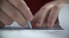 Detail of male hands working on a design Stock Footage