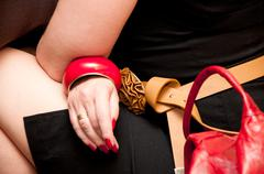 Red woman accesories bag and bracelet Stock Photos