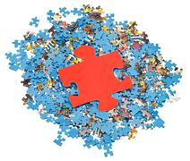 Big red piece on pile of disassembled puzzles Stock Photos