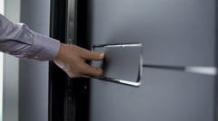 Close shot of person closing the door Stock Footage