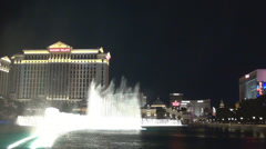 Water music show famous city fabulous Bellagio fountain Las Vegas strip night US Stock Footage