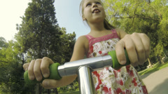 Child on scooter funning in park Stock Footage