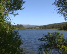 NORWAY,  Atn Valley - Settlement at lakeside +  blue lake under blue sky - stock footage
