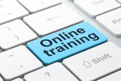 Education concept: Online Training on computer keyboard - stock illustration
