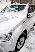 automobile under snow close up - stock photo