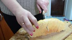 Woman hands knife bread Stock Footage