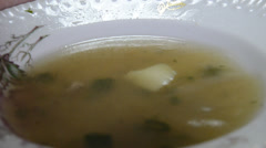 Spoon in a dish with fish soup Stock Footage