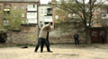 Eldery   and  young Actors train a fight scene on  street.Editorial  Footage