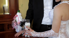 Bride and groom holding champagne glasses - stock footage