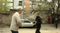 Eldery   and  young Actors train a fight scene on  street Footage