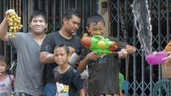 Group of Boys Enjoying the Songkran Festival Water Fights Stock Footage