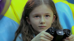 Child concentrated face, addicted to playing video games, fun - stock footage