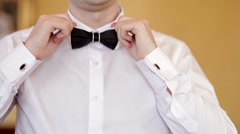 Man wears white shirt and bow tie Stock Footage