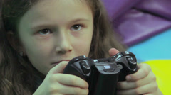 Happy child playing console game, time wasting, game addiction - stock footage