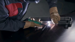 Welding metal part of the door - stock footage