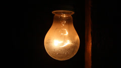 Turn on and off old lightbulb Stock Footage