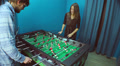 Young couple playing table football, communicating, having fun HD Footage