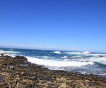 Turbulent ocean waves with white foam beat coastal stones, fuerteventura, can Stock Photos