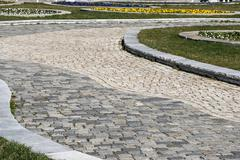 Paved park alley closeup - stock photo