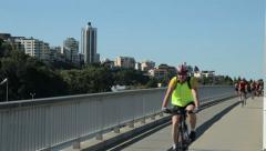Cyclist commuters uses cycle track along kwinana freeway, perth, australia Stock Footage