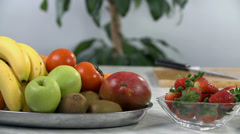 All kinds of fruit stacked on the plates Stock Footage
