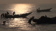 Fishermens silhouette and boats in Bengal sea, Tamilnadu,India Stock Footage