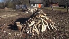 Chopped firewood  stack in farm garden Stock Footage