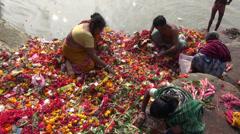 Prayers and flowers  near Dakshineswar Kali temple.India Stock Footage