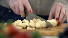 Close shot of slicing banana into tiny pieces Stock Footage