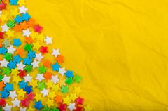 Multicolored stars on a background of crumpled paper - stock photo