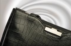 A black business handbag isolated on a graduated background Stock Photos