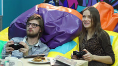 Young couple on date playing console, video game addiction, fun, click for HD - stock footage