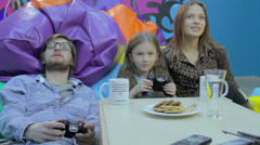 Family playing video game, gaming habit, time wasting, addiction, click for HD - stock footage