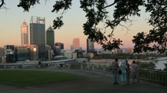 Tourists visit kings park at sunset to see perth skyline, australia Stock Footage