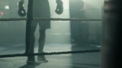 Male Boxer retreating to the Ring edge Stock Footage