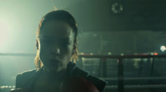 Female Boxer punches firecly inside the Boxing Ring Stock Footage