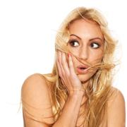 Beautiful blond with fluttering hair surprised - stock photo