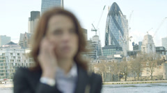 CU Business Woman makes a Business call by the River Thames Stock Footage