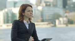 MS Business woman uses her digital tablet/ipad  Stock Footage