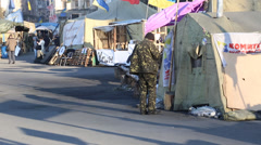 Soldier and citizens in maiden square, kiev Stock Footage