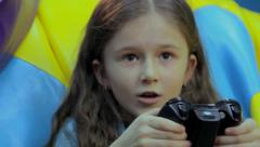 Child concentrated face, addicted to playing video games, fun, click for HD - stock footage