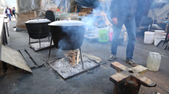 Open air cooking in cast iron pots at maiden square protest site in kiev Stock Footage