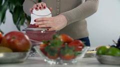 Blending red fruit in mixer Stock Footage